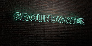 GROUNDWATER -Realistic Neon Sign on Brick Wall background - 3D rendered royalty free stock image Royalty Free Stock Photo