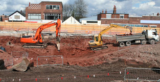 Groundwork. Diggers and heavy machinery work on the groundwork of a consrtruction project Royalty Free Stock Images