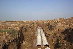 Groundworks in Punjab. Newly laid pipes in an open trench on a new construction site on the outskirts of Mohali Chandigarh Punjab India Royalty Free Stock Image