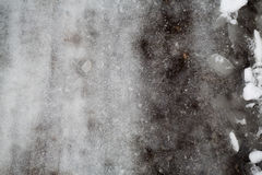 Groung melting snow dark gray. Winter melting snow dark gray background Stock Photo
