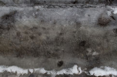 Groung melting snow dark gray. Winter melting snow dark gray background reflection in water Stock Photos