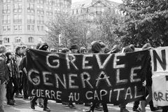 Grouop with covered face during protest Stock Photos