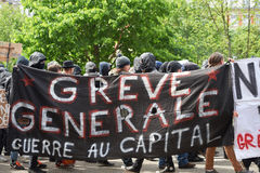 Grouop with covered face during protest Stock Photo