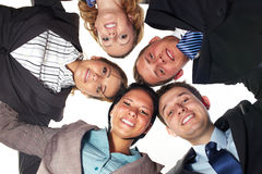 Group of 5 businesspeople in a circle, low angle Royalty Free Stock Photos