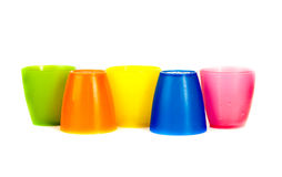 Group of 5 plastic mugs isolated Royalty Free Stock Photos