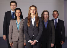 Group of 5 young confident businesspeople stock photos