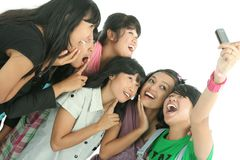 Group. Of young woman taken picture with mobile phone Stock Photography