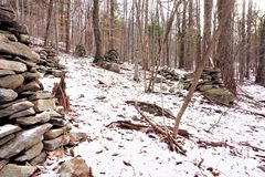 Group of abandoned cairns in Catskill Park. Catskill sandstone and greywacke are piled in angular towers and columns in haphazard layout in the deciduous woods stock photo