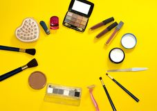 Group of accessories for makeup, hygiene and body care on yellow background. Woman& x27;s workplace with copy space. Salon spa stock photography