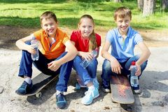 Active kids skateboarding Stock Images