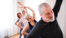 Group of senior people doing exercise in community center club. royalty free stock photo