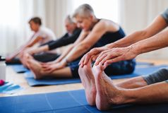 Group of senior people doing exercise in community center club. stock image