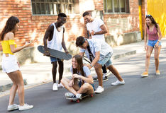 Group of active teenagers making recreational activity in an urban area. Stock Photos