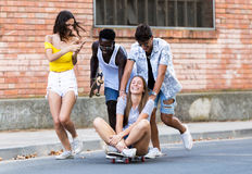 Group of active teenagers making recreational activity in an urban area. Royalty Free Stock Photography