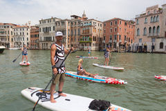 Group of active tourists stand up paddling on sup boards at Grand Canal, Venice, Italy. Stock Images