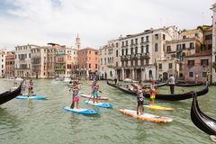 Group of active tourists stand up paddling on sup boards at Grand Canal, Venice, Italy. Royalty Free Stock Image