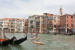 Group of active tourists stand up paddling on sup boards at Grand Canal, Venice, Italy. Stock Image