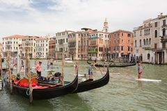 Group of active tourists stand up paddling on sup boards at Grand Canal, Venice, Italy. Stock Photography