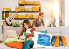 Group of active young people working on startup small business at home Royalty Free Stock Image