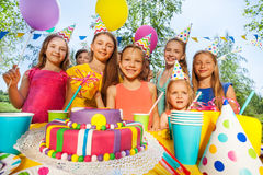 Group of adorable kids having fun at B-day party Royalty Free Stock Photos