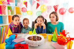 Group of adorable kids having fun at birthday party, selective focus Royalty Free Stock Images