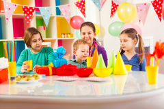 Group of adorable kids having fun at birthday party, selective focus Royalty Free Stock Image