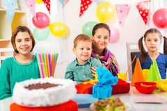 Group of adorable kids having fun at birthday party, selective focus Stock Photography
