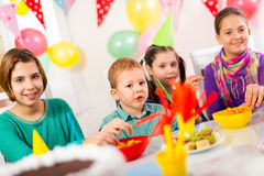 Group of adorable kids having fun at birthday party, selective focus Stock Image