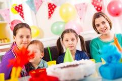 Group of adorable kids having fun at birthday party, selective focus Stock Photos