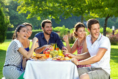 Family members laughing. Group of adult family members laughing heartily as they look over their shoulders at something off screen to the right Royalty Free Stock Photography
