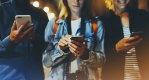 Group adult hipsters friends using in hands mobile phone closeup, street online wi-fi internet concept, bloggers together pointing. Finger on screen smartphone royalty free stock photos