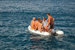 Group of Adult People in Small Boat Stock Image