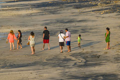 Group of Adult People Walking at Beach stock images