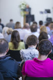 Group of Adult Professionals  Listening to the Lecturer Speaking on Stage Stock Images