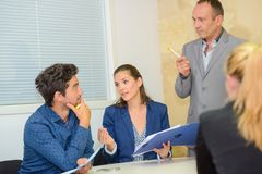 Group adults in discussion in meeting. Group of adults in discussion in meeting Royalty Free Stock Images
