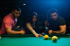 Group of adults having fun playing billiard Stock Photo
