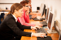 Group of adults learning computer skills. Intergenerational tran Royalty Free Stock Photo