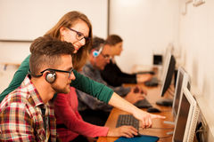 Group of adults learning computer skills. Intergenerational tran. Sfer of knowledge Royalty Free Stock Photo
