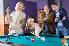 Group of adults playing pool Stock Image