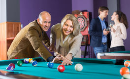 Group of adults playing pool Stock Photo