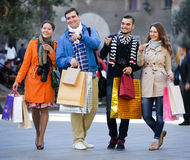 Group of adults with shopping bags Royalty Free Stock Photo