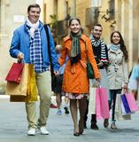 Group of adults with shopping bags Royalty Free Stock Image