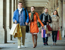 Group of adults with shopping bags Royalty Free Stock Images