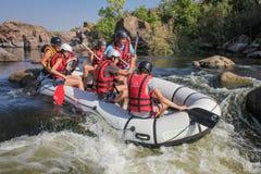 Group of adventurer enjoying water rafting activity at Southern Bug river. Mygiya / Ukraine - July 22 2018: Group of adventurer enjoying water rafting activity royalty free stock image