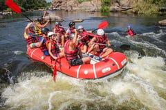 Group of adventurer enjoying water rafting activity at Southern Bug river. Mygiya / Ukraine - July 22 2018: Group of adventurer enjoying water rafting activity stock photo