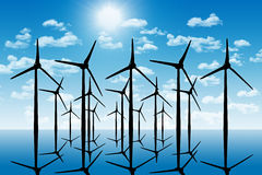 Group of aeolian windmills in perspective silhouette above the w Royalty Free Stock Image