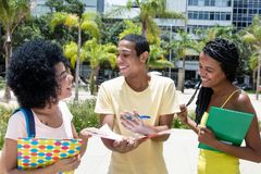 Group of african american students in discussion. Outdoors on campus in summer royalty free stock photography