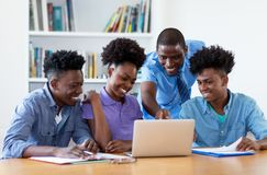 Group of african american students with male teacher. At university royalty free stock photo
