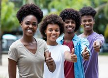 Group of african american young adults showing thumb up. Outdoor in the summer stock image
