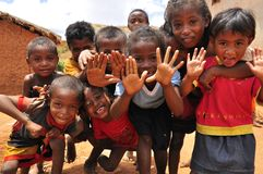 Group of african children playing with hands. Smiling happily. Madagascar, Africa royalty free stock images